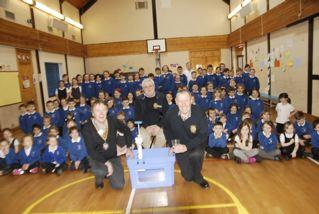 The Rotary members with the Aquabox with the School pupils looking on.