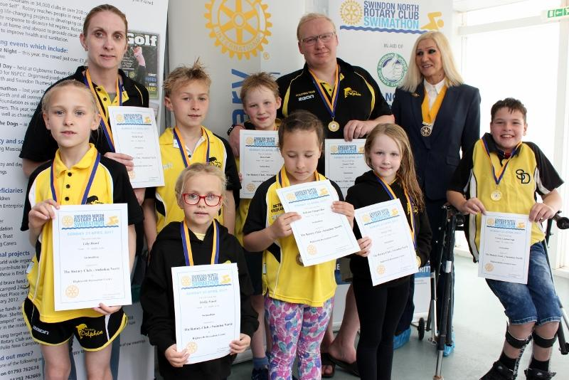 Rotary Club Vice President Ann Debureaux-Dias with some of the entrants from the Swindon Dolphins ASC