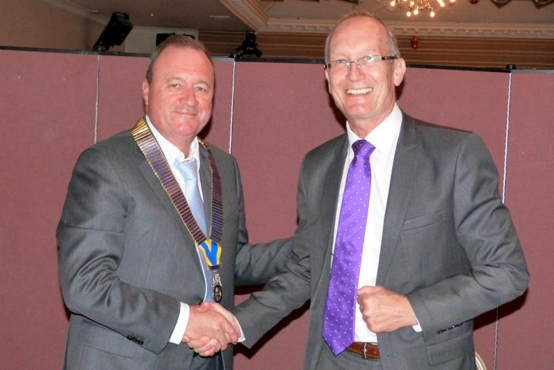 Past President Richard hands over to Chris Holmes.
