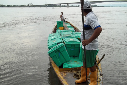 ShelterBoxes being transported by canoe