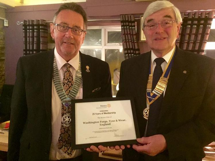 Club 25th Anniversary Meeting - DG Terry Long presents President Dave Neville with a certificate from Rotary International to mark the club's 25 years of Rotary Membership