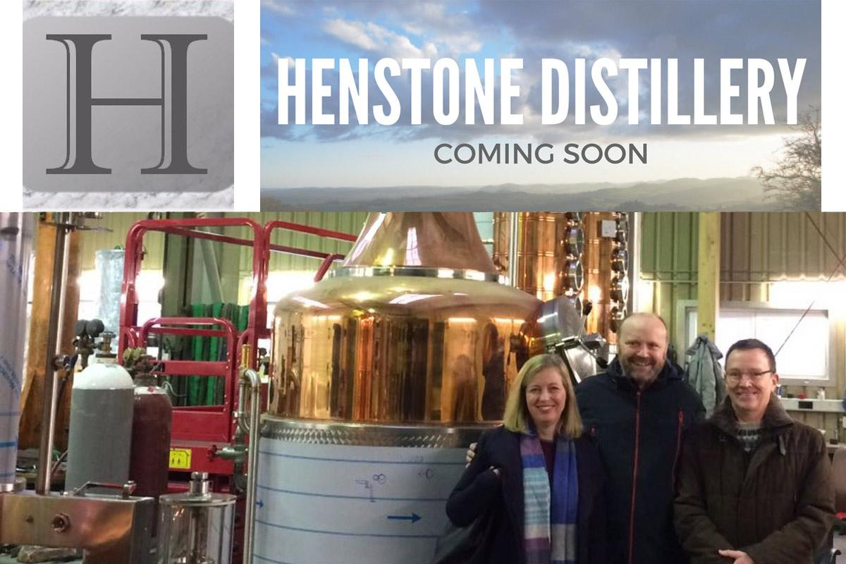 Henstone Directors Amy, Shane and Chris in front of a still on their purchasing trip to Germany.