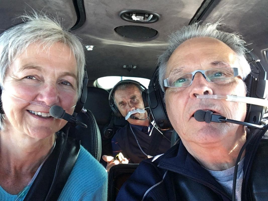 Reflection on our last six months - Ian Kerr with cabin crew donning oxygen at 25000 ft. !