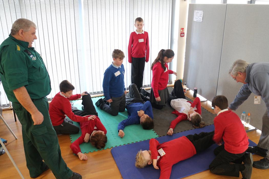 Learning about the 'recovery position' in the 1st Aid scenario.