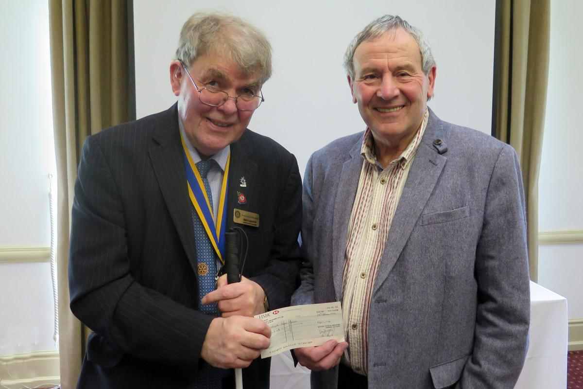 President Mark presents Graham with a cheque for Nightingale House Hospice
