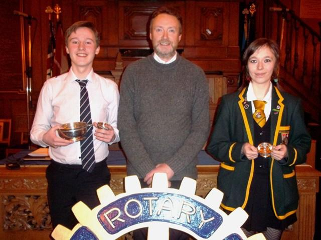 President Alan Lannigan along with Young Musician of the Year, Reece McInroy of James Hamilton Academy on the left and Hilary Newth of Grange Academy, the winning instrumentalist.