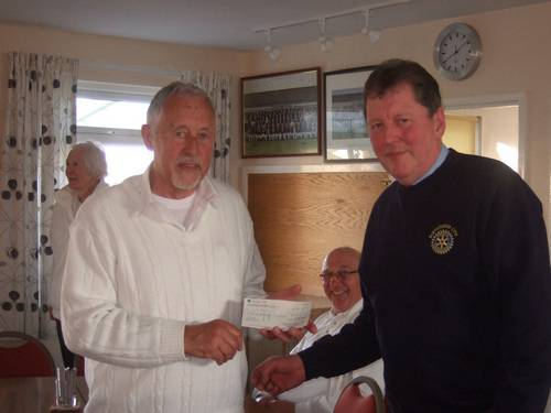 BOWLS EVENING 15th MAY 2013 - Pres Chas presents the grant from the Rotary Shop towards the cost of a new modern mower.