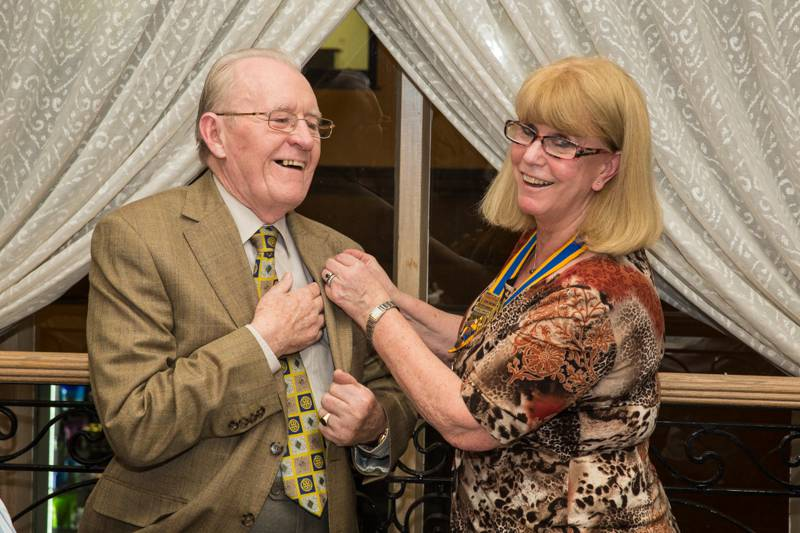 2014-01-22 Honorary member and Good Companions Club - Cliff Blanchet receives his new Rotary badge from President Toni.