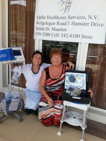 Caribbean Footcare Project - Dr Grace Spencer and Debra Alpha outside the St Maarten clinic, with showing the footcare equipment