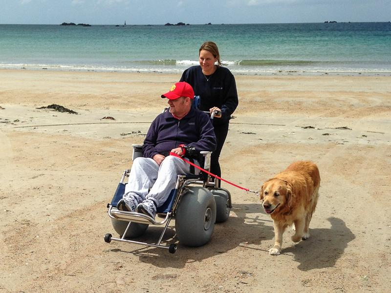 BeachAbility  - One man and his dog enjoy a trip to the beach