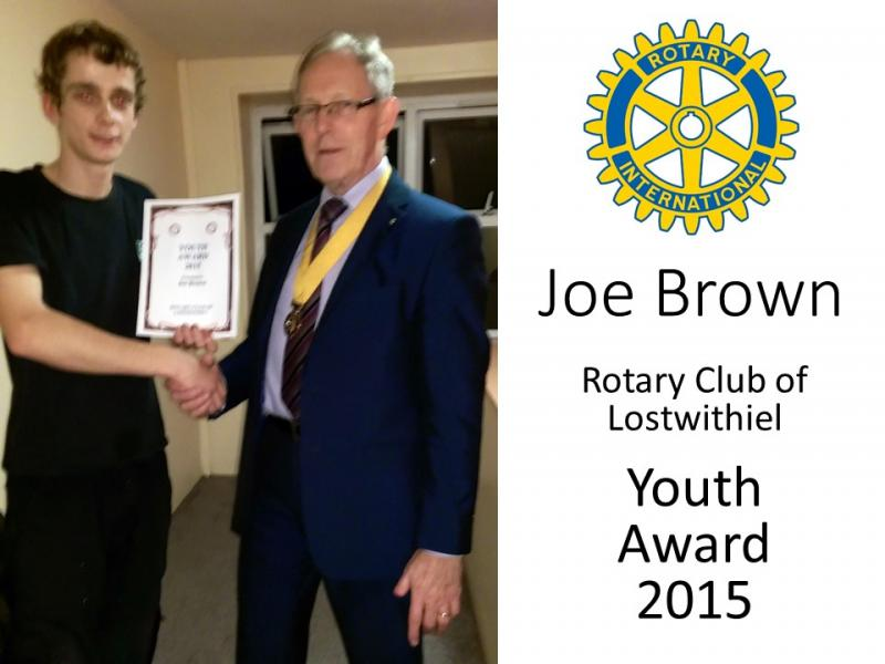 Joe receiving the award from President Elect, Andrew Jeffery