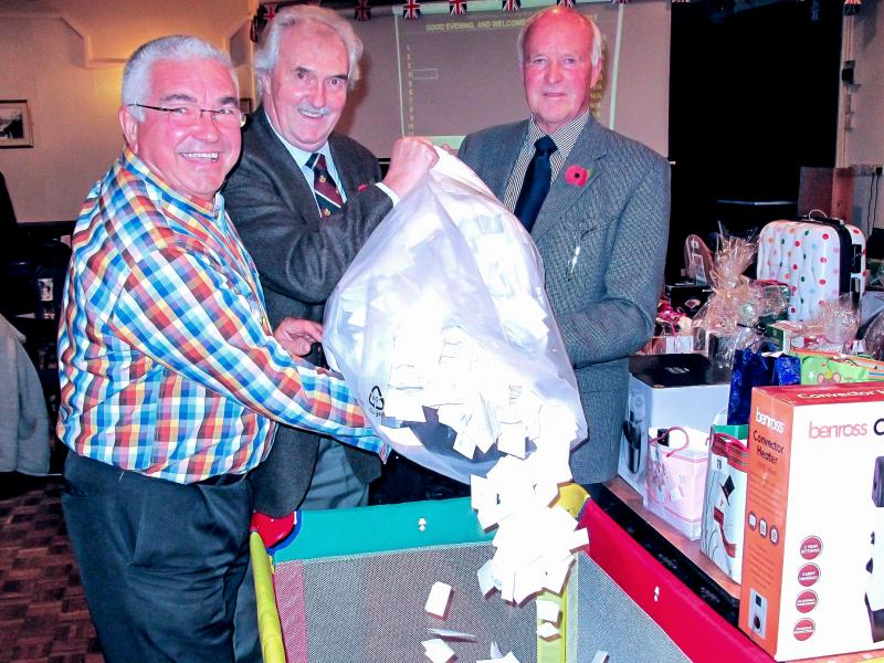 Megadraw main organiser Lew Baglow, Council Leader Des Brailey and Barnstaple Link Rotary President Mike Willcox filling the draw container with 20,000 Megadraw ticket stubs
