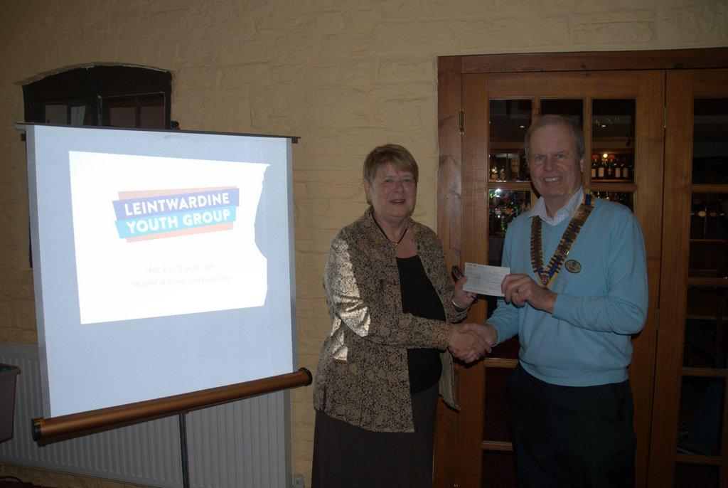 Dinner and speaker at the Baron - Patrick presents Sheila with a donation for LYG