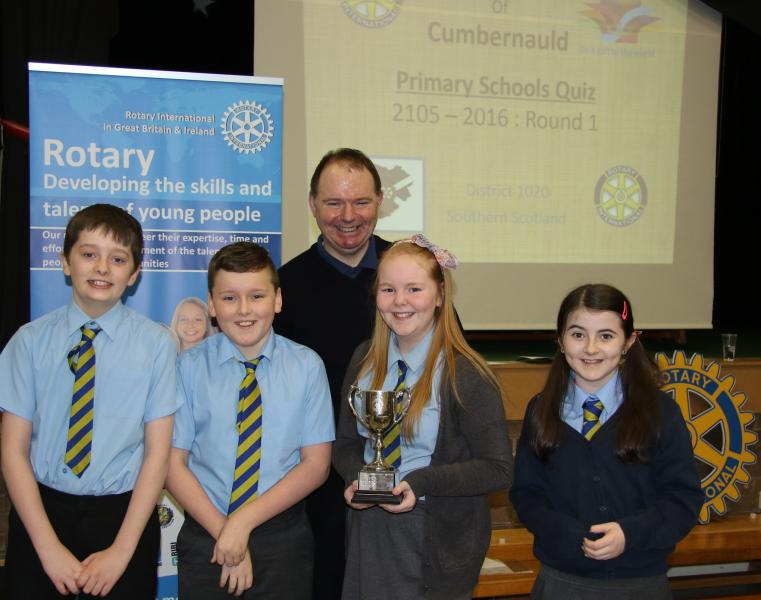 Henry Gaffney, Daniel Shaw, Rachel McAuley, and Colette Carr from St Helen's Primary School, pictured with Kenny MacGregor of the Rotary Club of Cumbernauld