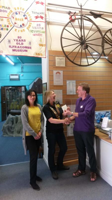 President Erica presenting the cheque for £250.
