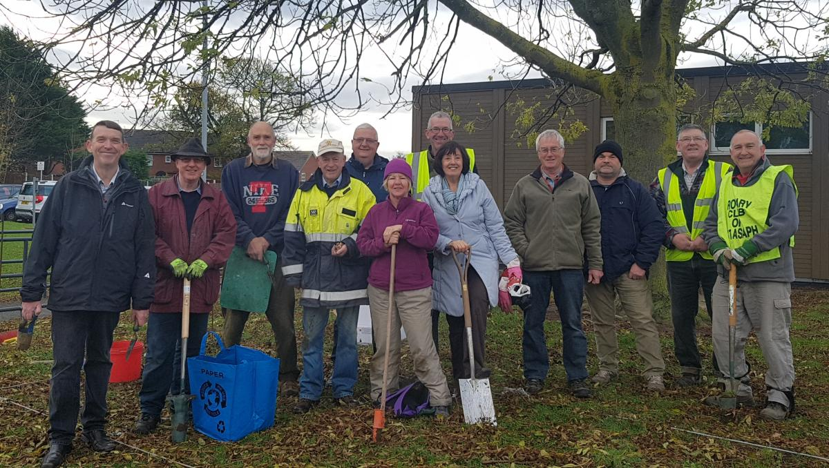 Planting Purple for Polio at Rhuddlan Library  - Planting Rotary Purple Crocuses at Rhuddlan Library