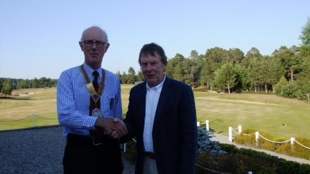 Recent Club Activities - 2018-19 President, Gus Carnegie (left) accepts the chain of office from 2017-18 President, Gavin Stewart at the Handover Dinner in Grantown Golf Club