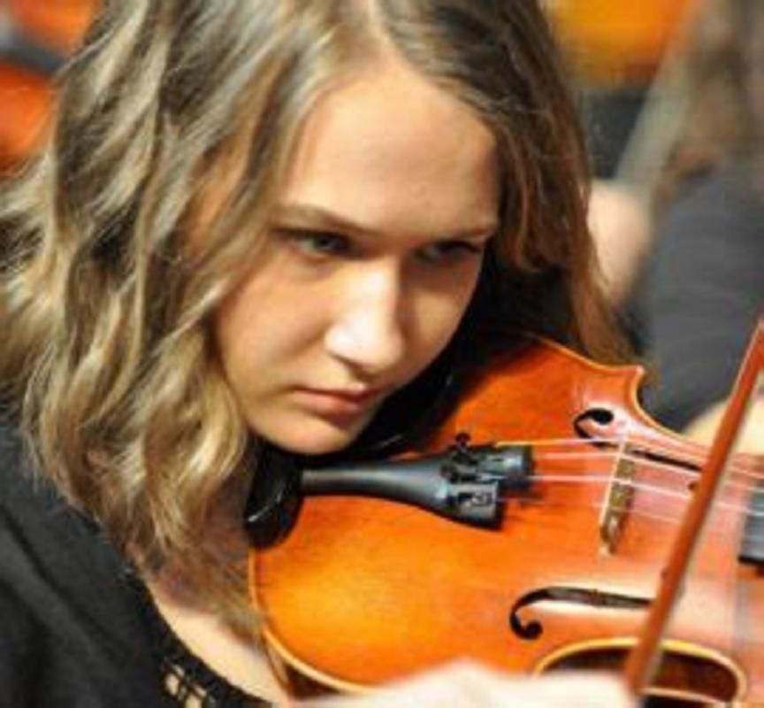 Young musician at the concert