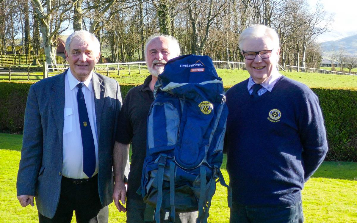 President Brian Mitchelhill&Rotarian Bob Harwood at the presentation of the ruckdacks to Nick Landells from the Cumbria Alliance.