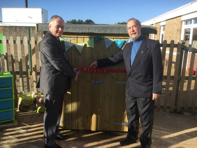 Opening of the Library Shed at Berry Hill school - Rotarians Paul Brading and Tom Gifford opening the new library shed