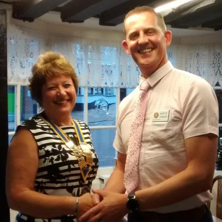 Outgoing President Martin Stibbards passes on the President's chain of office to incoming President Jackie Wellman