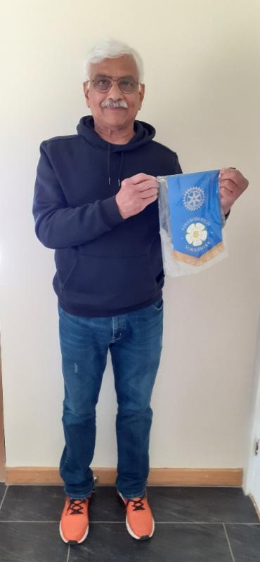 President Raj Mani with Aireborough's banner featuring the Yorkshire White Rose