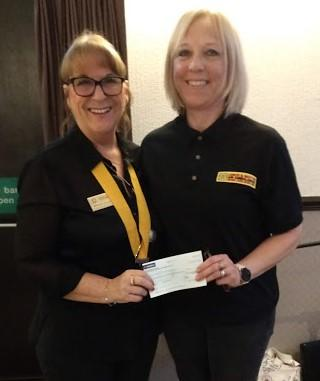 Maggie presents cheque to Heather of Air Ambulance