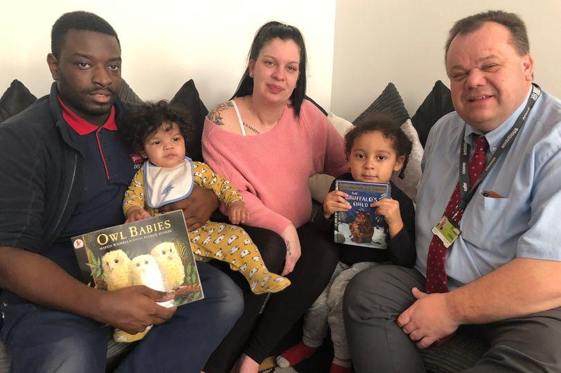 Councillor David Mellen with the 5,000th child to receive the free books, baby Remae Gordon-Goode, with dad Raelle, mum Melanie and sister Kyron (Image: Nottingham City Council)