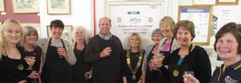 Some of the volunteers at the ArtHouse Cafe celebrate raising over £50,000 for local good causes