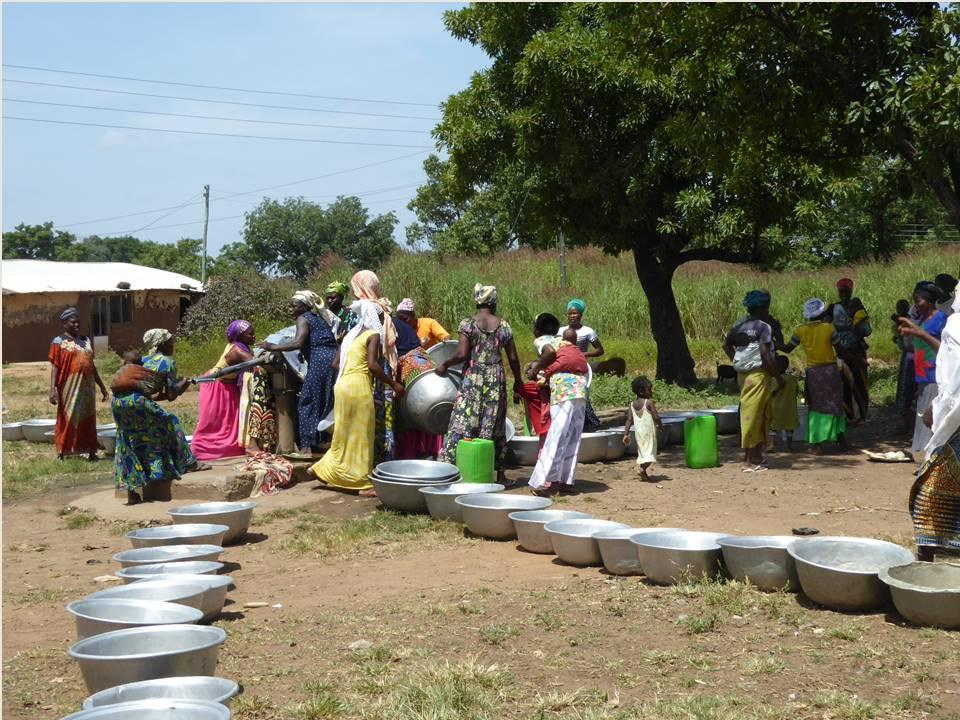 Lining up for water from the boreholes (Ghana)