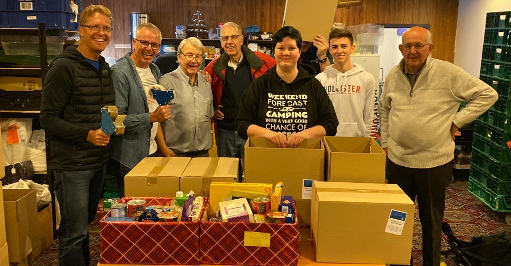Christmas Hamper Appeal 2020 - Gemma Jimmison from the Wakefield Express and members of the Rotary Club of Wakefield Chantry packing hampers in 2019.