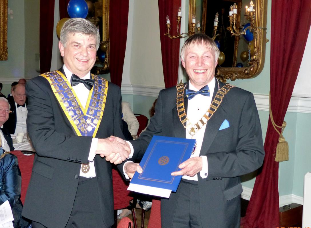 Rotary District 1080 Governor Derek Rothwell (right) presenting a special citation from the President of Rotary International, John F Germ, to celebrate the 90th Anniversary of the Rotary Club of King's Lynn to the Clubs President Michael Pellizzaro