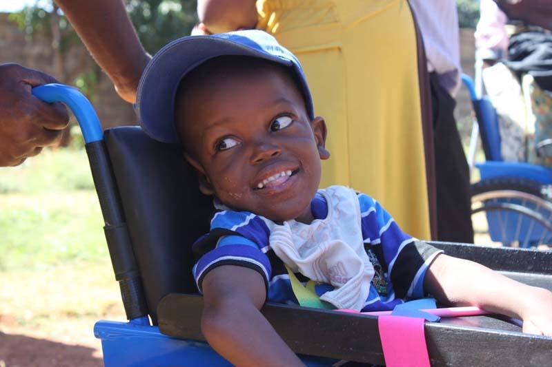 Aka Nyambe from Chilenje in his first ever wheelchair. Transformed his life, and that of his mother.