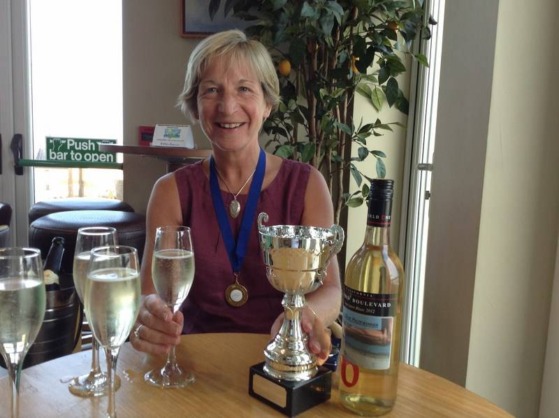 Susan celebrating with her Cup for winning a 10k race