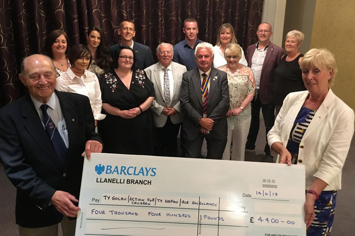 Llanelli Rotary Club presents £4400 to local charities - Llanelli Rotary Club presents £4400 to local charities, proceeds of the annual Santa's Grotto.