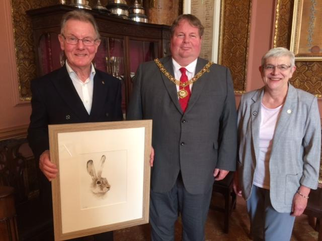 Past President Gerry Rees, and Stella Tonks, Joint President, with  the Lord Mayor, showing last year's winning picture