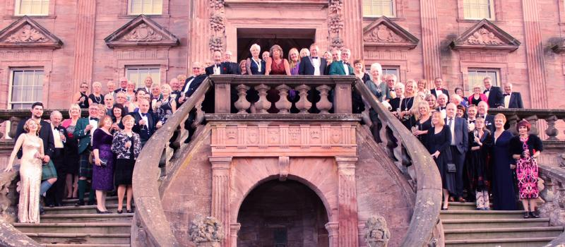 40th Anniversary Charter Dinner - Picture shows Rotarians and guests gathered on the steps of Drumlanrig Castle.