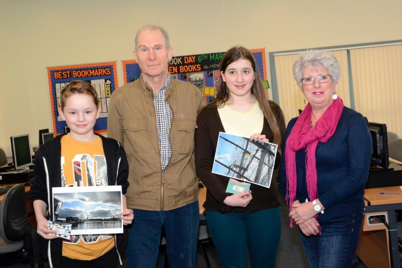 Picture shows Connor and Josie with their winning photographs. Also in the picture are Ed Baxter and Thornhill Rotarian Joan Neilson.