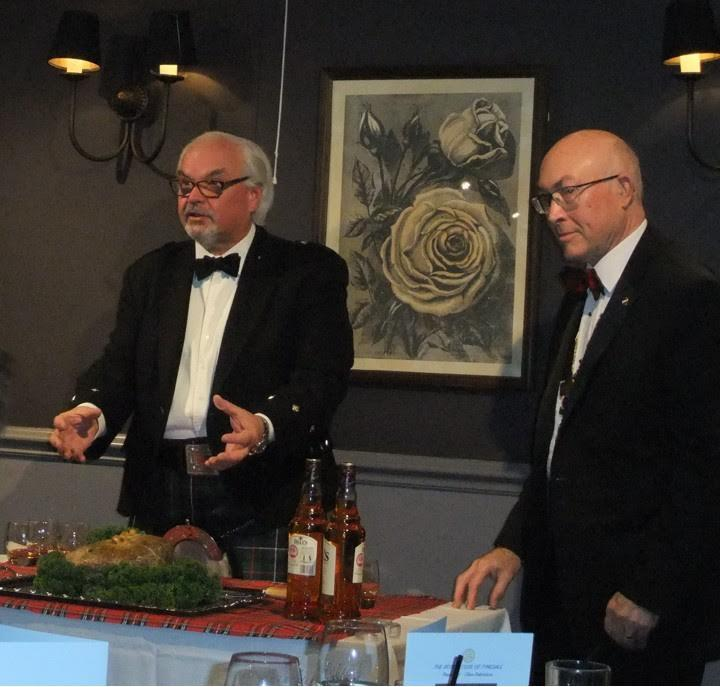 Rotarian David Innes addressing the haggis. President Clive Robertson eagerly awaiting his share of haggis and whiskey!