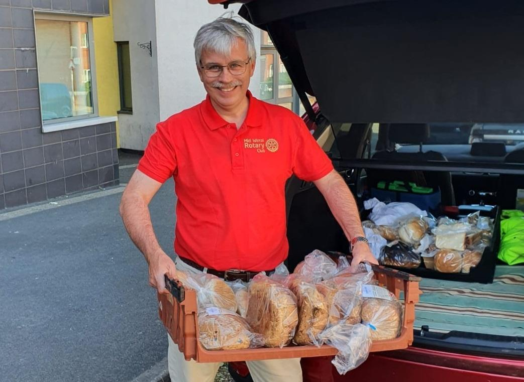 Mid Wirral Rotary member with produce ready for donation to Birkehead YMCA