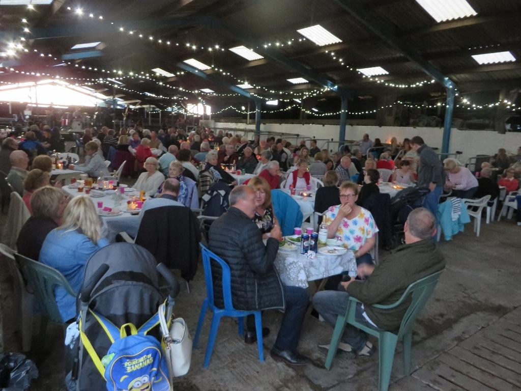 Rotary and Inner Wheel Annual BBQ - Guests enjoying the entertainment and food