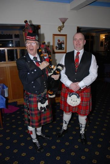 BURNS NIGHT 2015 - Piper Barry McQueen with Alf Clempson who addressed the haggis and gave the toast to The Immortal Memory of Robert Burns.