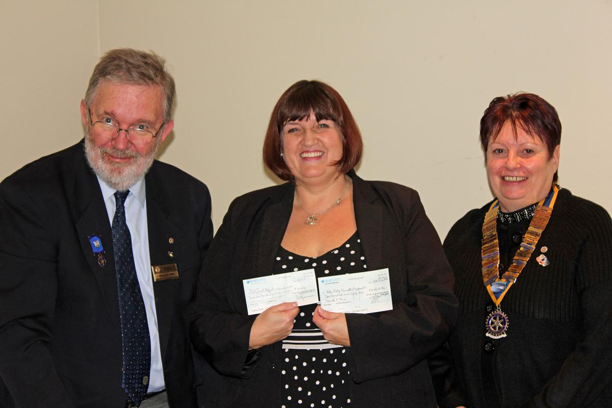 Treasurer Mike presents the cheque