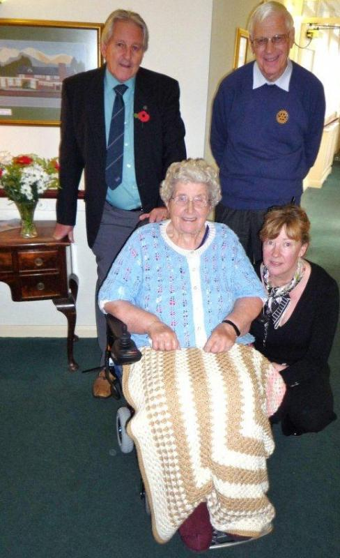 Betty Stevenson receiving a Wheelchair from Nantwich Rotary