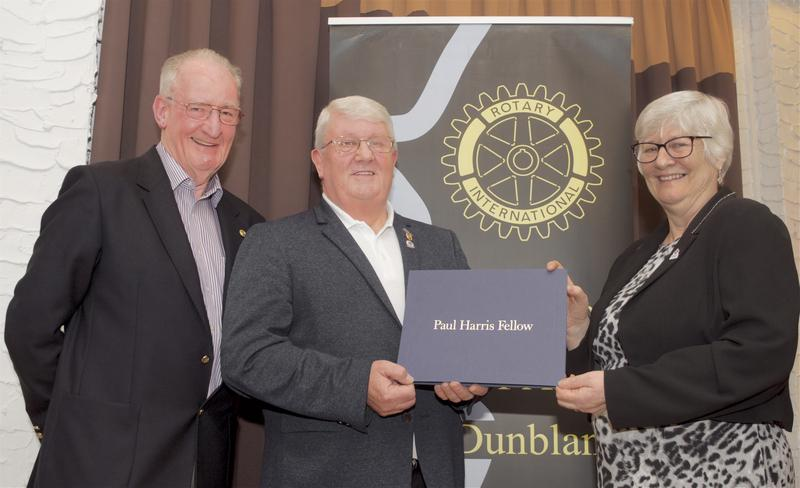 John Kilby with District Governor Ian Dowe presenting Paul Harris Fellowship to Breda Seaman in Dunblane