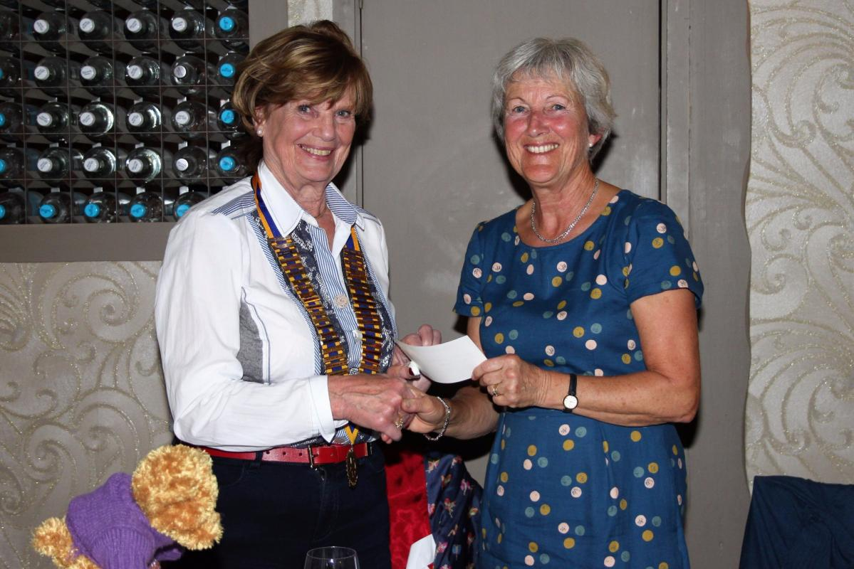 Caroline receives a donation from President Margaret Crowe