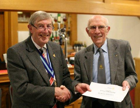 Celebration of Long Service - Brian Whitaker receives cerificate from PDG Rod Walmsley