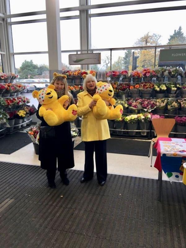 President Clare and Rotarian Gill enter into the spirit of collecting with Pudsey Bear