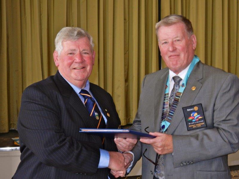 Chris clark's 50th Anniversary in Rotary - Chris receives Certificate for 50 years Service to Rotary from DG Fred King