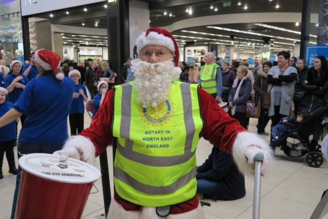 Christmas Street Collection - Bob in his usual Santa Claus outfit assisting in Eldon Square